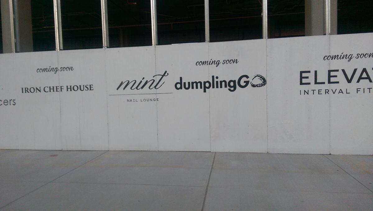 """Coming Soon"" signage at Mosaic [Photo: Missy Frederick]"
