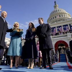 Joe Biden is sworn in as the 46th president of the United States by Chief Justice John Roberts as Jill Biden holds the Bible during the 59th Presidential Inauguration at the U.S. Capitol in Washington, Wednesday, Jan. 20, 2021, as their children Ashley and Hunter watch.