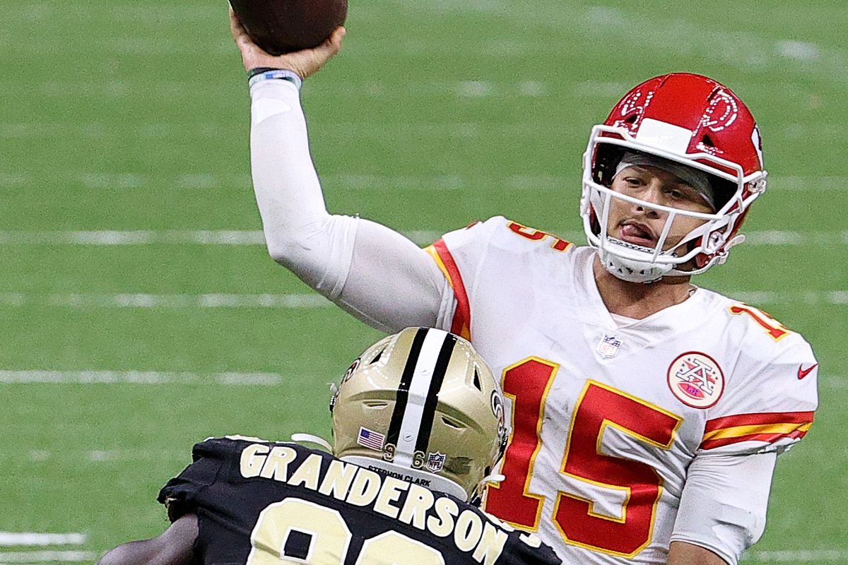 Patrick Mahomes #15 of the Kansas City Chiefs throws under pressure by Carl Granderson #96 of the New Orleans Saints during the fourth quarter in the game at Mercedes-Benz Superdome on December 20, 2020 in New Orleans, Louisiana.