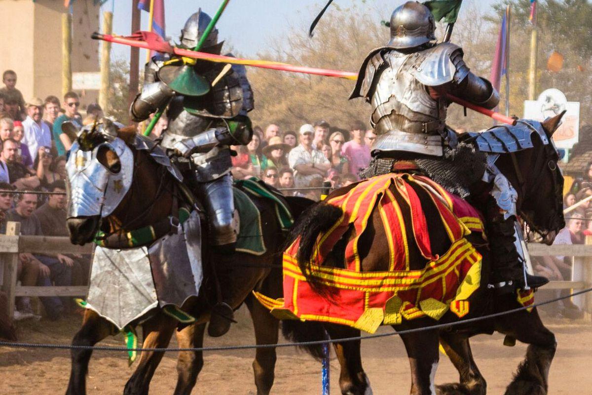 Two jousters on horseback at a renaissance festival.