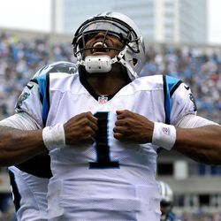 Carolina Panthers' Cam Newton (1) reacts after running for a touchdown against the New Orleans Saints during the fourth quarter of an NFL football game in Charlotte, N.C., Sunday, Sept. 16, 2012. The Panthers won 35-27.