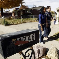 Candidate Mia Love and campaign manager Matt Holton walk door to door in West Valley City on Friday, Nov. 2, 2012, talking to residents about her campaign.