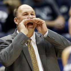 FILE: Brigham Young Cougars head coach Jeff Judkins calls out to his players as BYU and Utah State play an NCAA women's basketball game in Provo on Wednesday, Dec. 6, 2017. Utah State won 76-69.