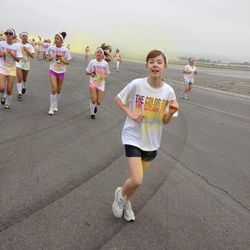 Daphne Brass celebrates her favorite color — yellow — as well as finishing the first kilometer of The Color Run.