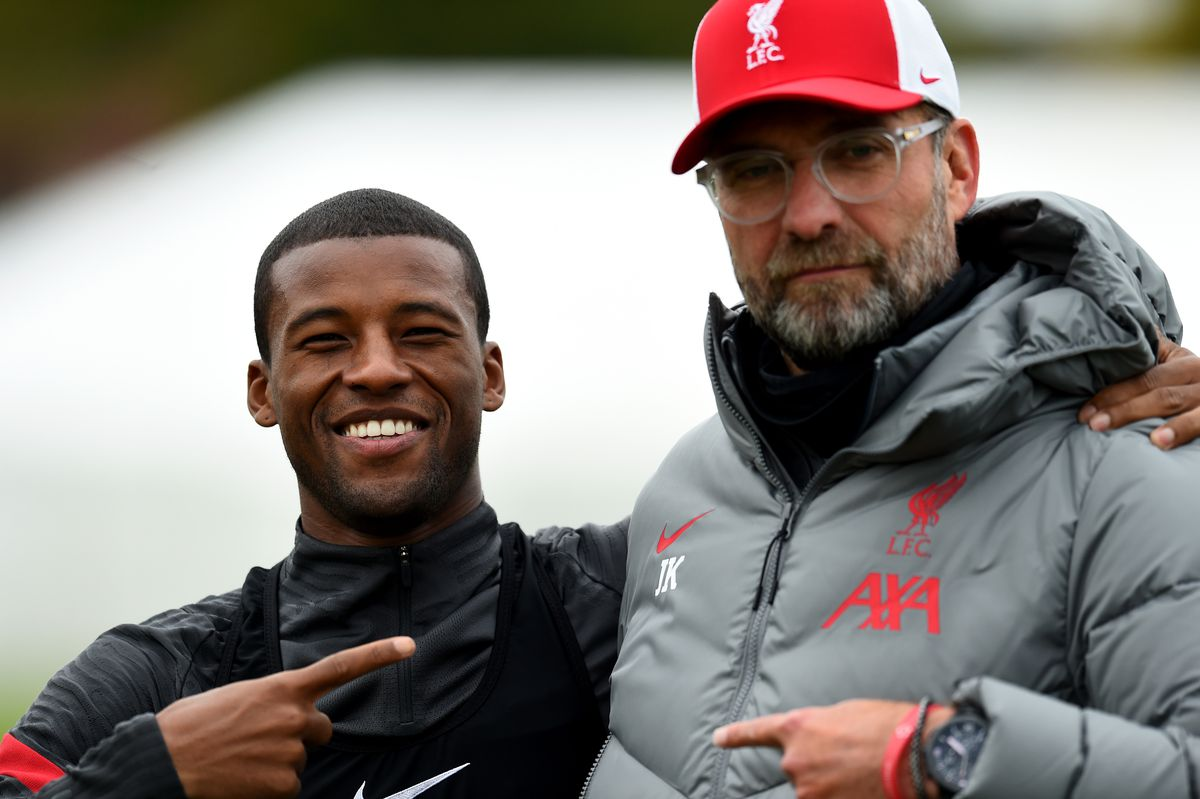 Wijnaldu poses with Klopp as the club prepares to move from Melwood to their new training ground. The two men point to each other, Gini smiling widely.