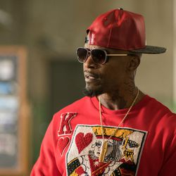 """Bats (Jamie Foxx) listens to the plan in """"Baby Driver."""""""