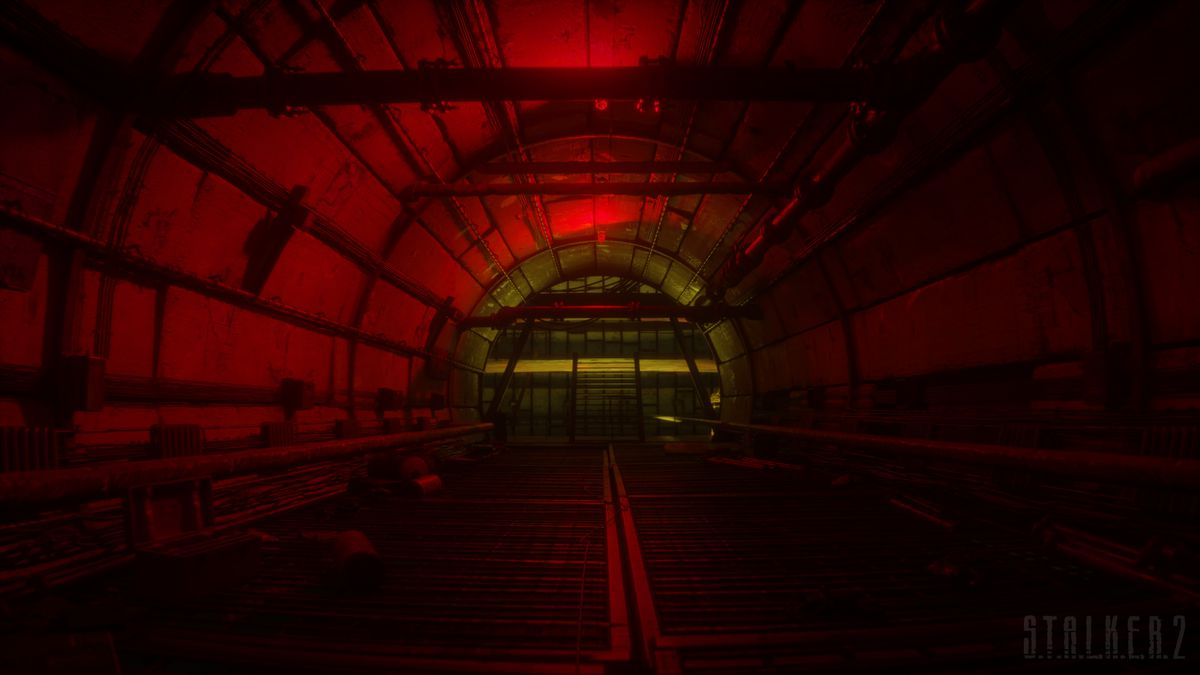 An underground tunnel lit with red light.