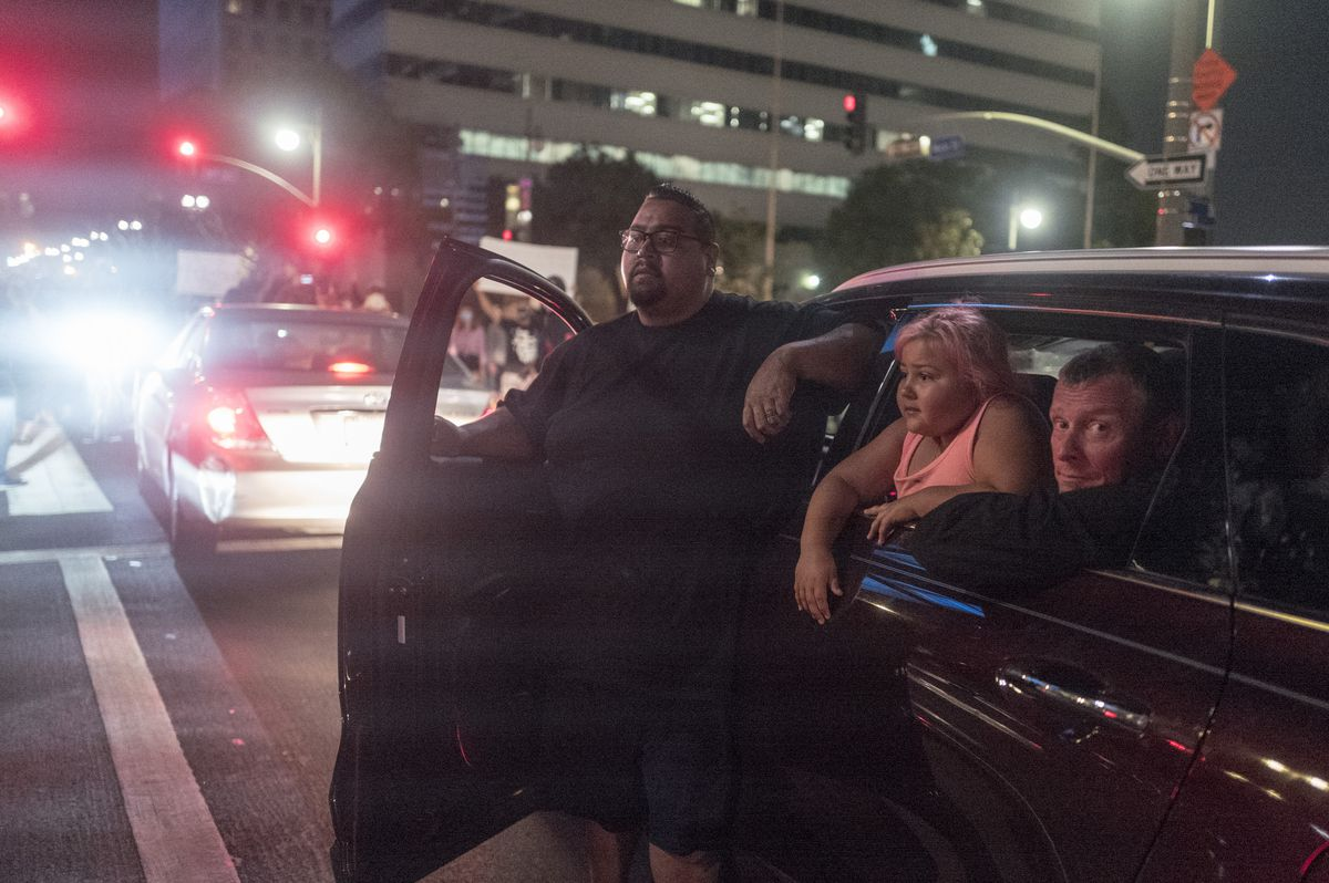 People watch from their car as demonstrators block traffic during a protest of the death of George Floyd, a black man who was in police custody in Minneapolis, in downtown Los Angeles, Wednesday, May 27, 2020. (AP Photo/Ringo H.W. Chiu)