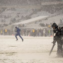 Grounds keepers use blowers to clear the lines at Lincoln Financial Field