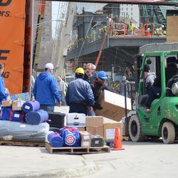 12:53 p.m. Still a mess on Waveland, unloading the Cubs gear truck -