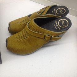 Calfhair clogs (damaged), $50