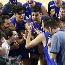 BYU players begin celebrating with the winning trophy after defeating Pepperdine in the finals of the Mountain Pacific Sports Federation Championship, at the Smith Field House in Provo on Saturday, April 24, 2021. BYU won in straight sets.