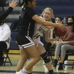 Highland's Cecilia Olevao traps Skyline's Cami Groberg along the baseline during a game at Skyline High School in Salt Lake City on Tuesday, Feb. 16, 2021.
