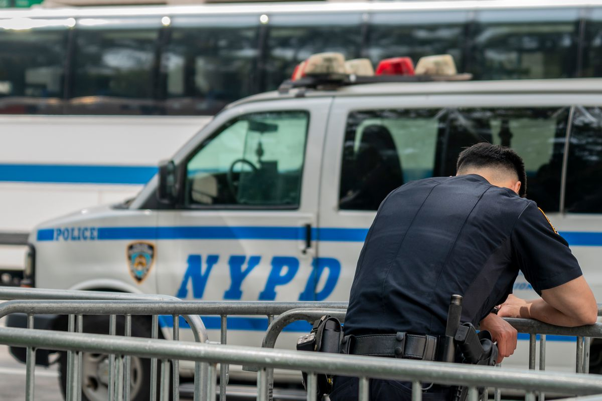 An NYPD officer stands guard in lower Manhattan, Sept. 25, 2020.