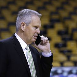 Boston Bruins General Manager Danny Ainge talks on the phone before an NBA basketball game in Boston, Wednesday, March 1, 2017.