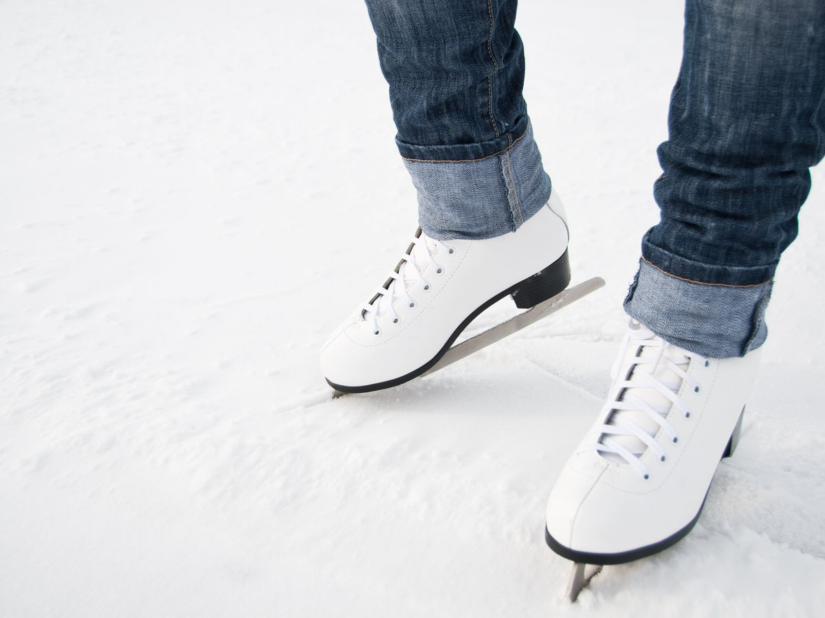 A pair of ice skates on an ice rink.