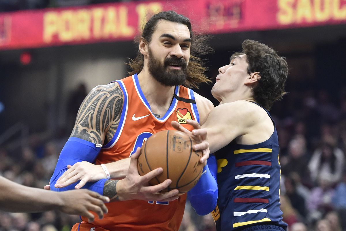 Oklahoma City Thunder center Steven Adams drives against Cleveland Cavaliers forward Cedi Osman in the second quarter at Rocket Mortgage FieldHouse.
