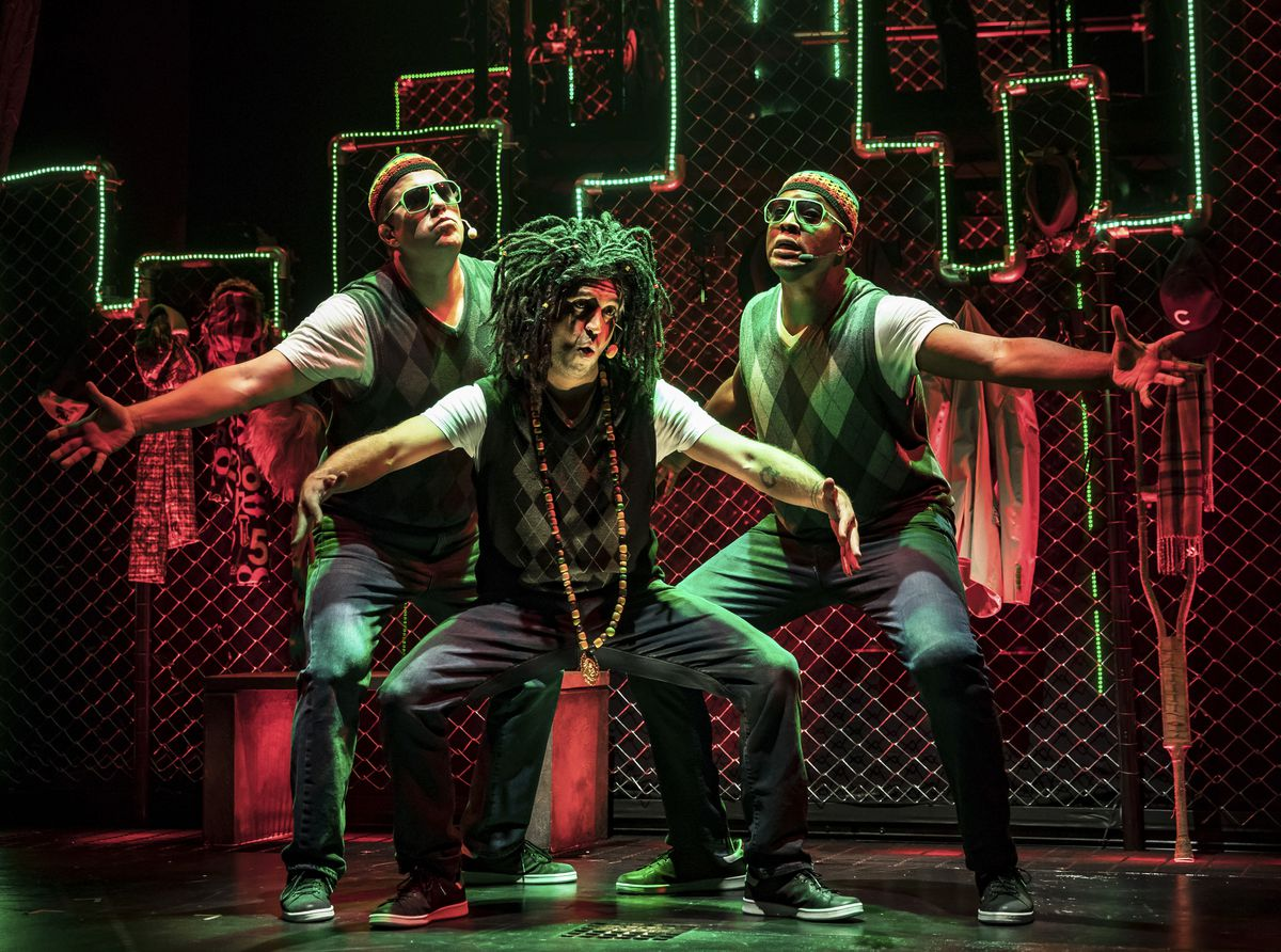 """A Rastafarian Jacob Marley (JQ, center) and his crew of reggae spirits (left to right, Jax and Pos) haunt Scrooge in Chicago Shakespeare Theater's production of""""QBrothers ChristmasCarol."""""""