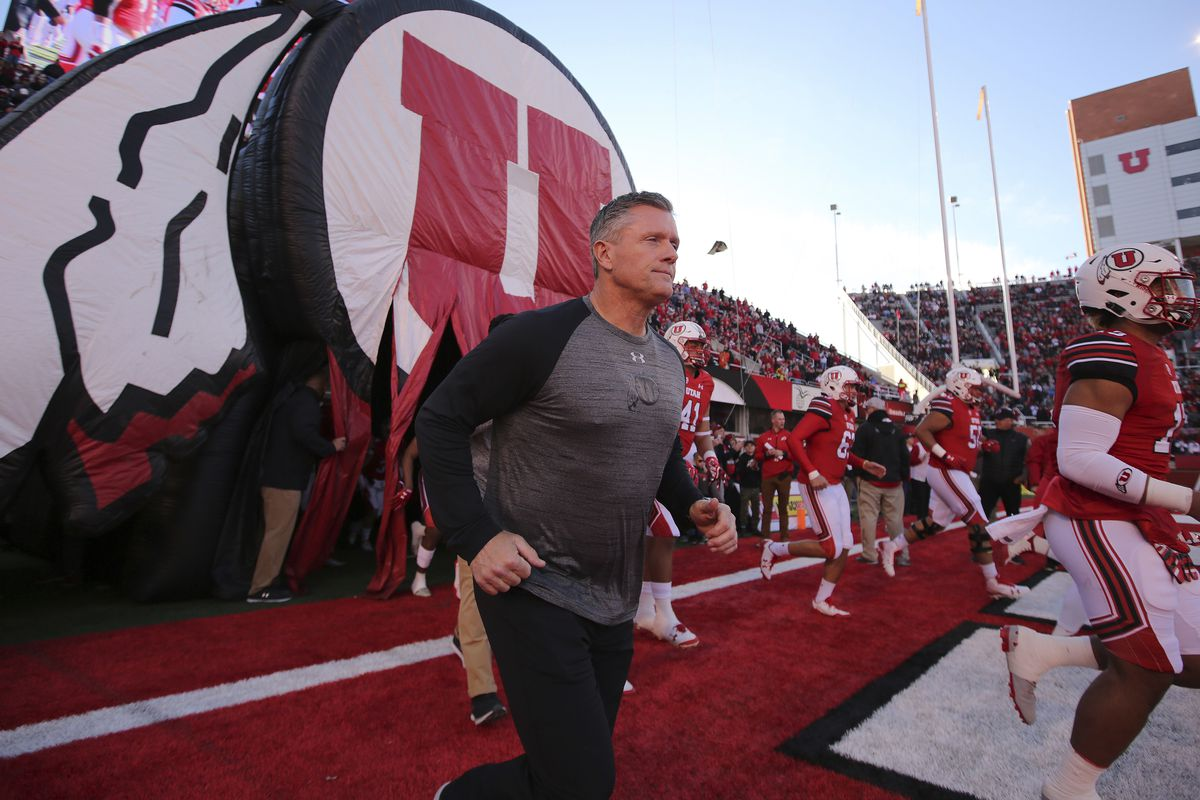FILE - In this Nov. 11, 2017, file photo, Utah head coach Kyle Whittingham and Utah players take the field during an NCAA college football game against Washington State, in Salt Lake City. While the two Los Angeles teams adjust to new quarterbacks, and th
