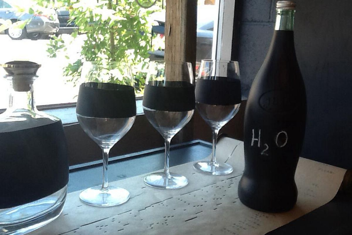 """These chalkboard wine glasses would be handy at Mercantile's farewell party. Image via <a href=""""https://www.facebook.com/TheMercantileShop/photos/pb.245141098834178.-2207520000.1409008155./873565479325067/?type=3&amp;theater"""">Facebook</a>/Mercantile"""