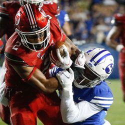 Utah Utes running back Micah Bernard (2) gets pressured by BYU's defense during the second half of an NCAA college football gameat LaVell Edwards Stadium in Provo on Saturday, Sept. 11, 2021. BYU won 26-17.