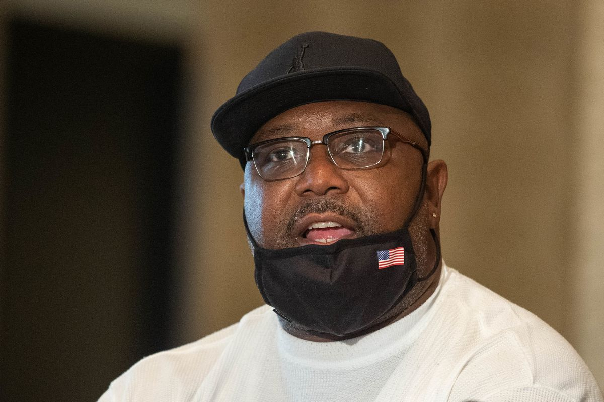 Darren Green Sr. demands justice for his son during a press conference Wednesday at the Parkway Ballroom in Bronzeville.