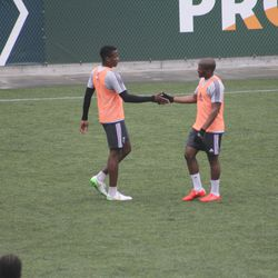 Powell and Nagbe congratulate each other after a well-worked play.