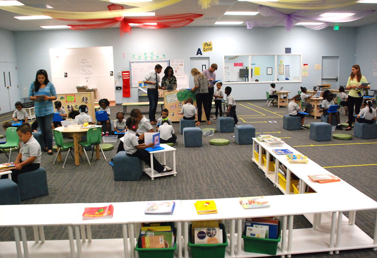 """Students work independently at stations in this large open room, called """"The Grove."""""""