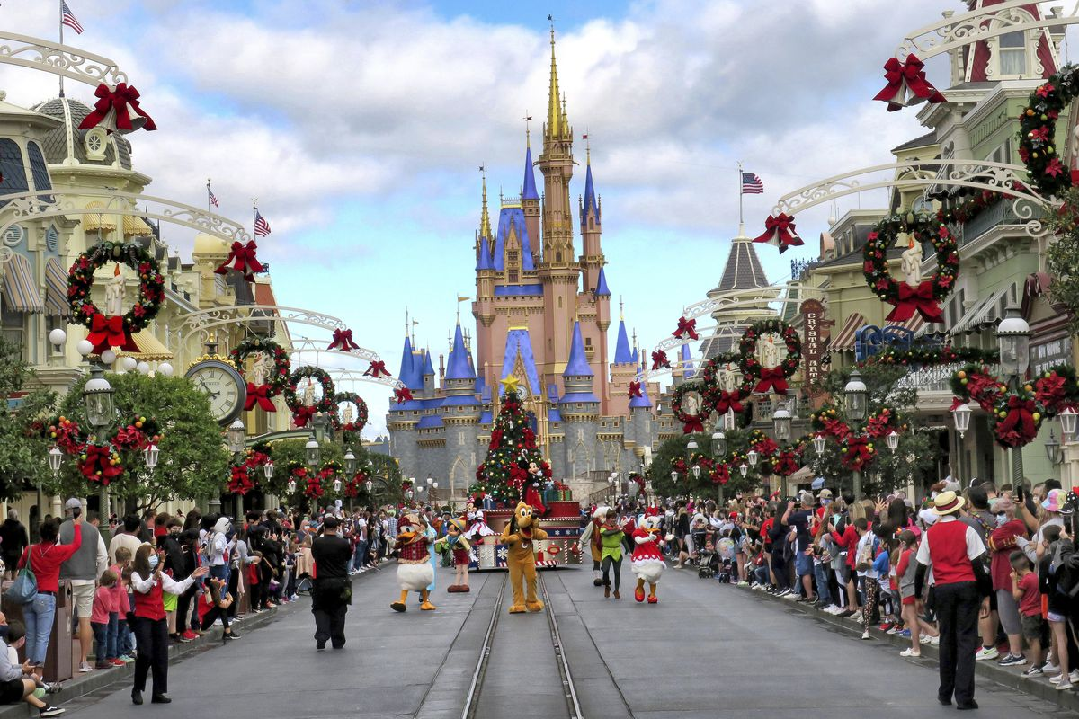 Crowds line Main Street USA, with Cinderella Castle on the horizon, at the Magic Kingdom at Walt Disney World, in Lake Buena Vista, Fla., Monday, Dec. 21, 2020. Disney's Florida parks are currently operating at 35% capacity due to the Covid-19 pandemic.