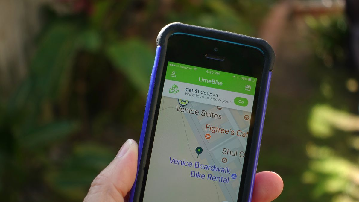 A cellphone with a map on it. The map and app read LimeBike.