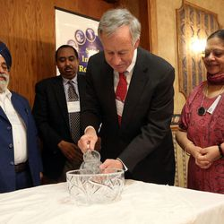 J.B. Singh, left, Osman Ahmed, Jim Jardine and Indra Neelameggham participate in a water ceremony, each pouring water into a common bowl to symbolize different faiths coming together in harmony, during the Interfaith Roundtable's annual Interfaith Prayer Breakfast at the Hellenic Cultural Center in Salt Lake City on Thursday, Feb. 5, 2015.