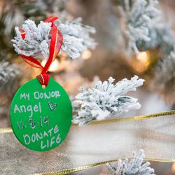 Ornaments decorated by guests at a ceremony hosted by Intermountain Donor Services hang on a Christmas tree in Salt Lake City on Wednesday, Dec. 21, 2016.