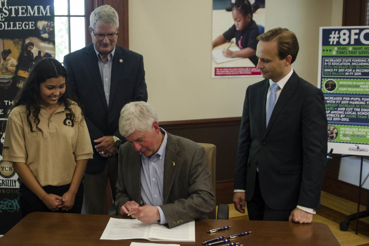 Gov. Rick Snyder signs his final education budget, which once again raises the threat of closure for the state's lowest performing schools.