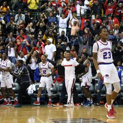 Curie's Ramean Hinton (23) cheers after they won the CPS championship, 65-60 over Morgan Park at Chicago State University in Chicago, Sunday, February 17, 2019. | Kevin Tanaka/For the Sun Times