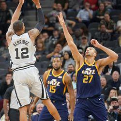 San Antonio Spurs' LaMarcus Aldridge (12) shoots against Utah Jazz' Rudy Gobert during the first half of an NBA basketball game, Saturday, Feb. 3, 2018, in San Antonio. (AP Photo/Darren Abate)