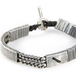 "For the accessories aficionado: M. Cohen Curved Bar Bracelet, <a href=""http://www.amrag.com/shopping/men/m-cohen-curved-bar-bracelet-item-10720423.aspx"">$700</a> at American Rag Cie"