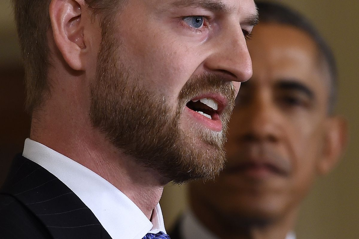 Dr. Kent Brantly, an Ebola survivor who was working on the relief effort in West Africa until he fell ill, with President Obama in the background.