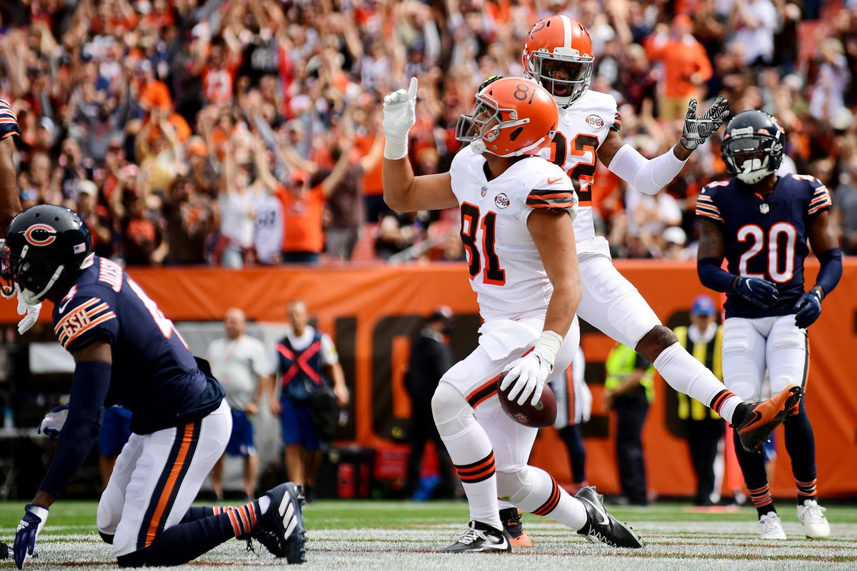 Austin Hooper #81 celebrates his touchdown with teammate Rashard Higgins #82 of the Cleveland Browns during a game between the Cleveland Browns and Chicago Bears at FirstEnergy Stadium on September 26, 2021 in Cleveland, Ohio.