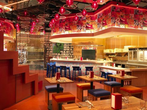 The interior of a restaurant in red and yellow