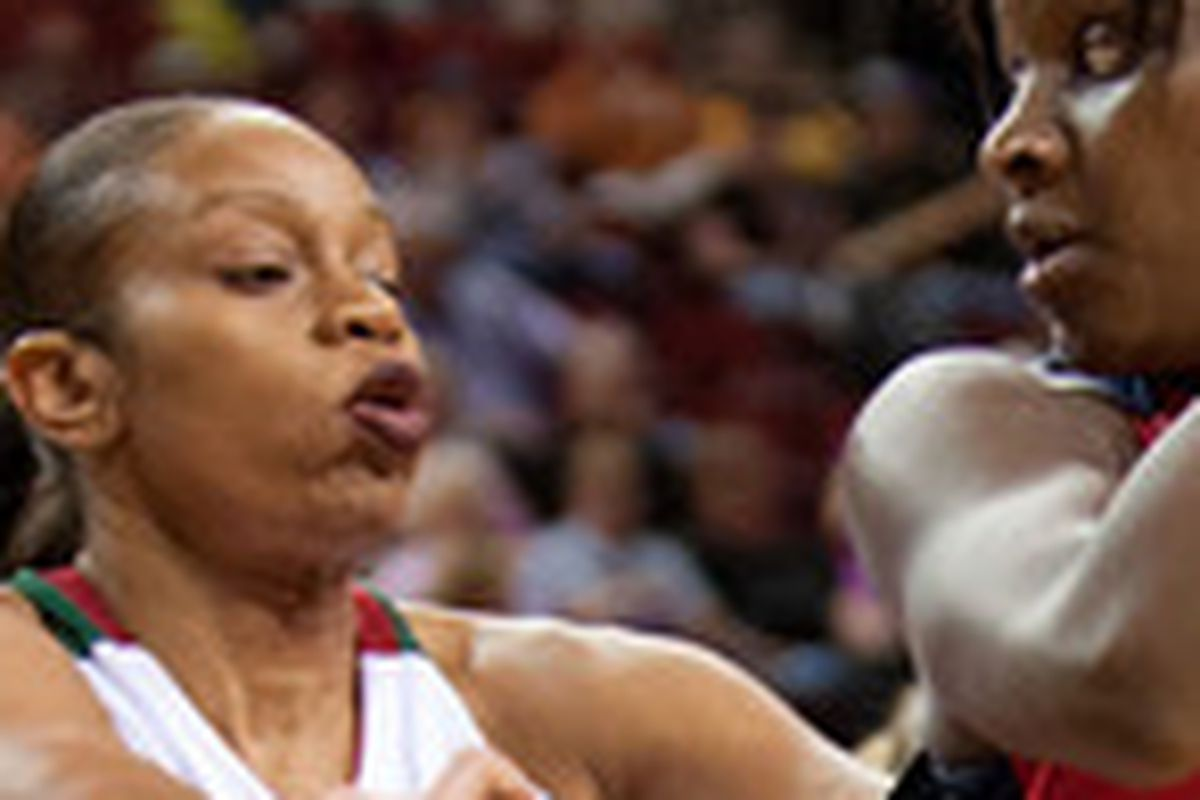 Tina Thompson (left) and the Storm got the better of Crystal Langhorne (right) and the Mystics on Tuesday night.