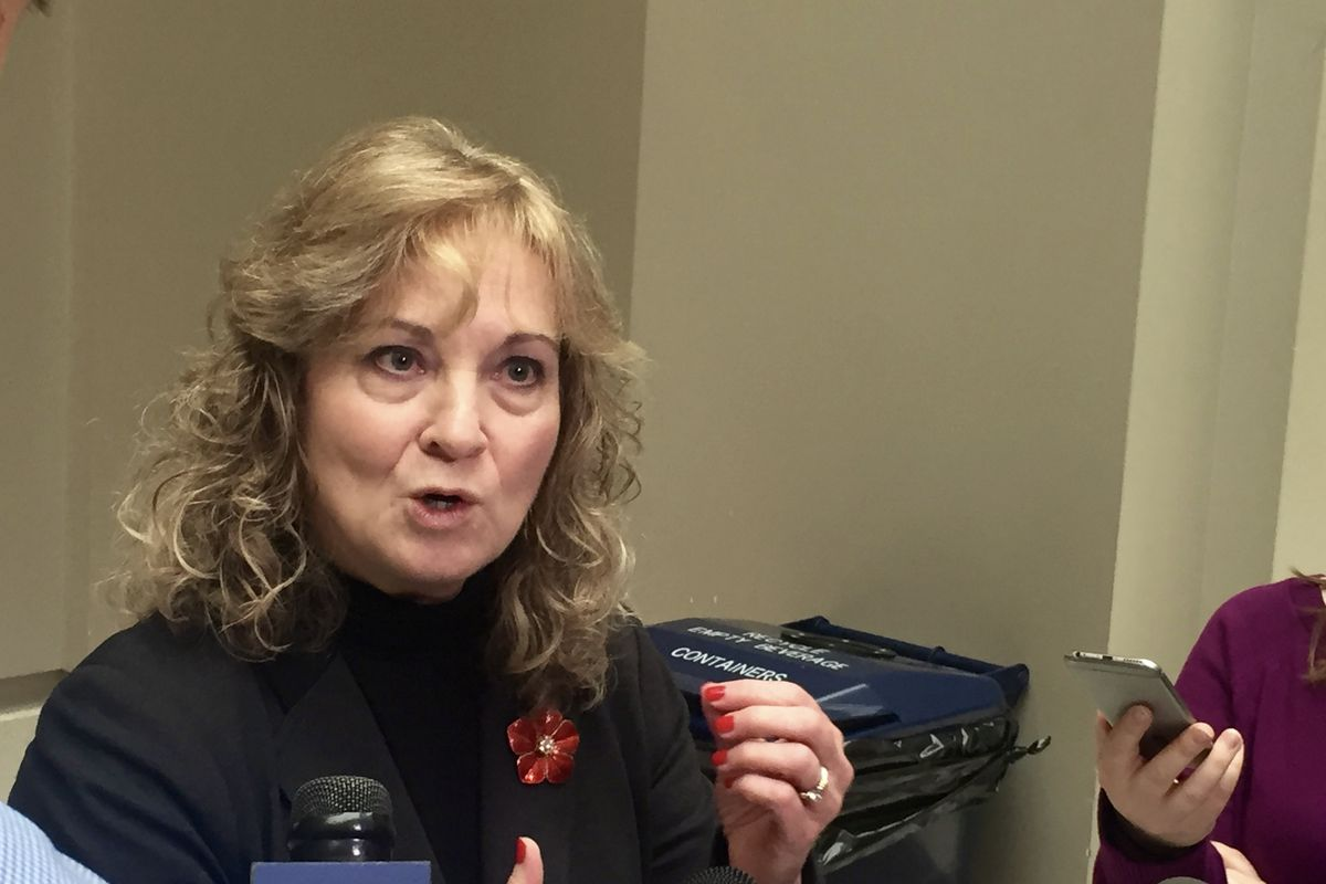 State Superintendent Glenda Ritz talks with reporters following an Indiana State Board of Education meeting in 2016.