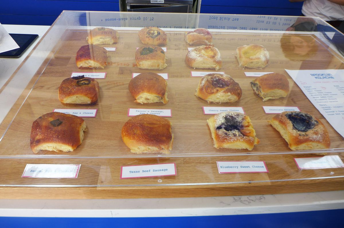 A plastic tray with two dozen sweet roll choices.
