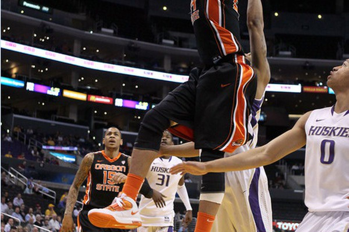 Devon Collier dunks against Washington for 2 of his team-high 19 points, which helped lead Oregon St. to the 86-84 win in the Pac-12 Tournament <em>(US Presswire photo)</em>
