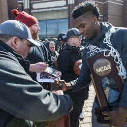 Donte Ingram signs an autograph on a fan's basketball. | Tyler LaRiviere/Sun-Times