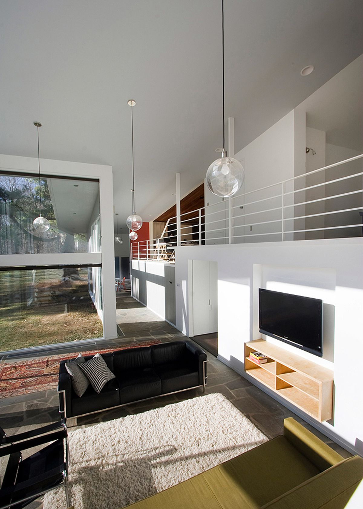 Living room with couches and large windows