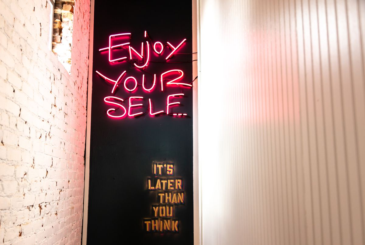 Banshee's unofficial mantra, emblazoned in neon on the back wall