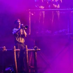 Buglers blow on their horns as the start of the celebration. Thousands of scouts and their leaders assemble Tuesday, Oct. 29, 2013 in the Conference Center in Salt Lake City to celebrate a century of honor.