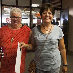 Leslie McWilliams, left, prepares to marry her partner of 18 years, Sheri Ault, at the Salt Lake County Clerk's Office in Salt Lake City, Monday, Oct. 6, 2014.