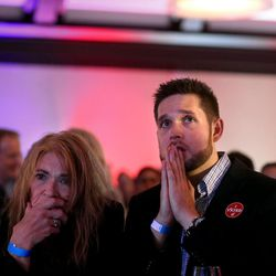Valerie Maciel and her son, Sal, watch as Donald Trump continues to beat Hillary Clinton at the Utah Democrats' election night party at the Sheraton Hotel in Salt Lake City on Tuesday, Nov. 8, 2016.