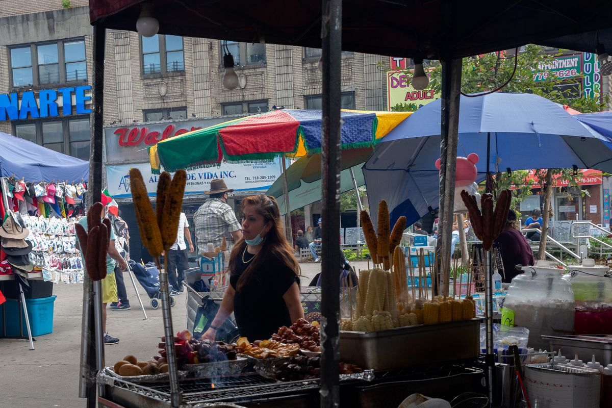 Street vendors sell food in Corona, Queens, Sept. 2, 2020.